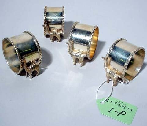 1P: SET OF FOUR STERLING NAPKIN RINGS