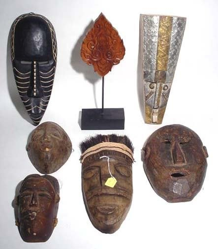 401J: BOX LOT OF DECORATED AFRICAN MASKS