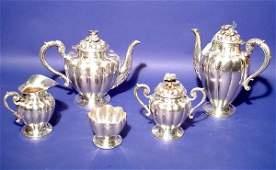 103: FIVE-PIECE STERLING SILVER TEA AND COFFEE SERVICE,