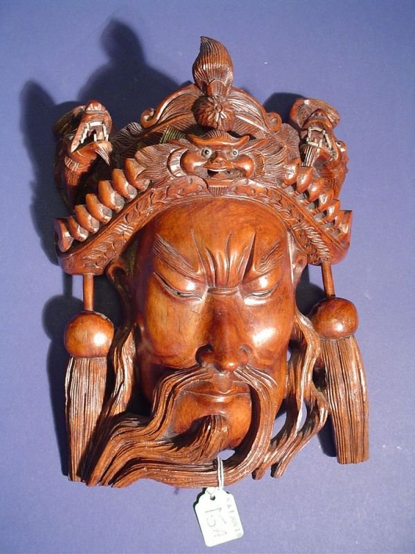 15A: WELL-CARVED SOUTHEAST ASIAN TEAKWOOD MASK OF A BEA
