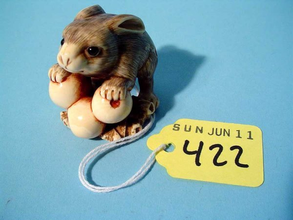 422: WELL-CARVED AND TINTED IVORY NETSUKE OF A RABBIT L