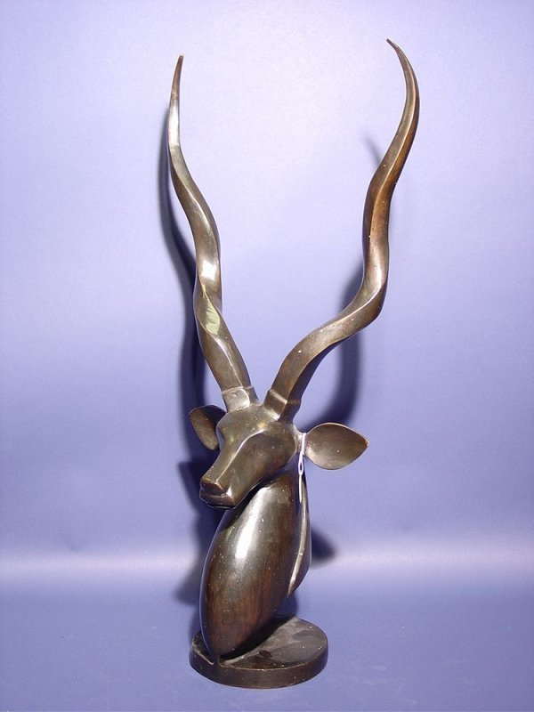 415: STYLIZED PATINATED BRONZE SCULPTURE OF AN ANTELOPE