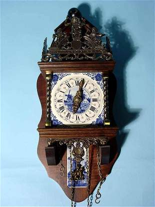 DECORATED DELFT PORCELAIN AND WALNUT WALL CLOCK, 20