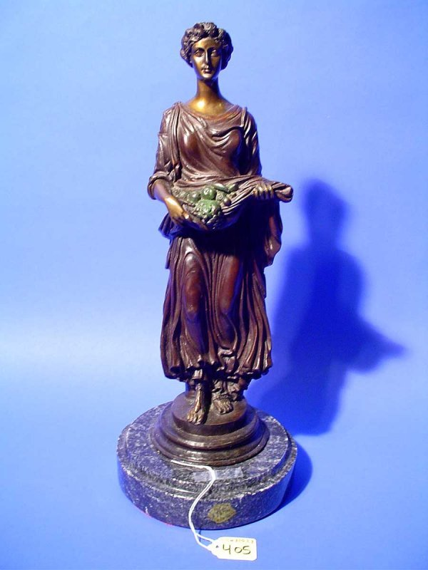 19: PATINATED BRONZE SCULPTURE OF A STANDING YOUNG WOMA
