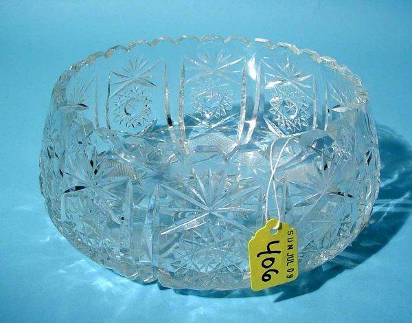 406: CUT GLASS CIRCULAR BOWL, having a knotched edge, w