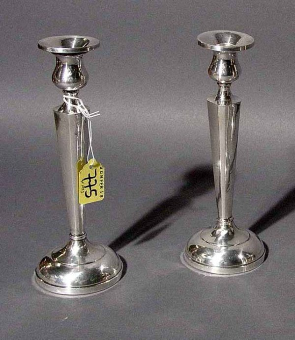 410: PAIR OF STERLING WEIGHTED CANDLESTICKS, of waisted
