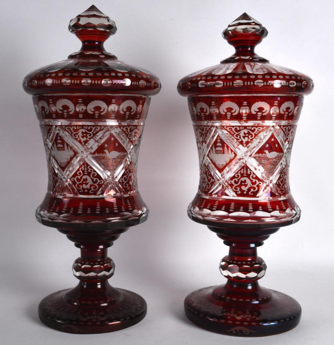 A FINE PAIR OF VERY LARGE BOHEMIAN RUBY GLASS GOBLETS