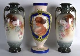 A PAIR OF LATE VICTORIAN TWIN HANDLED PORCELAIN VASES