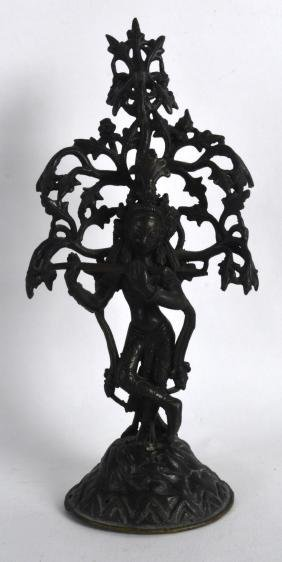 AN 18TH/19TH CENTURY INDIAN BRONZE FIGURE OF KRISHNA