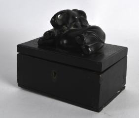 AN EARLY 20TH CENTURY CARVED AND EBONISED WOOD BOX with
