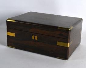 A MID VICTORIAN ROSEWOOD BRASS BOUND WRITING BOX with