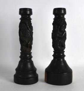 AN UNUSUAL PAIR OF EARLY 20TH CENTURY AFRICAN CARVED