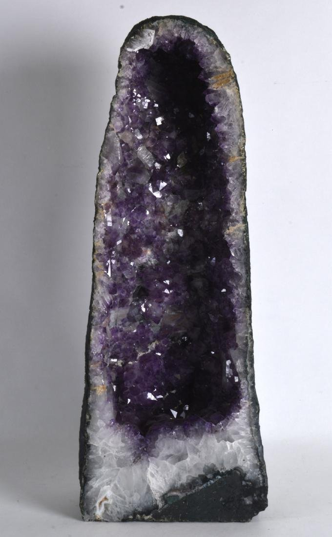 A STYLISH NATURALISTIC CARVED AMETHYST OPEN PILLAR. 1Ft