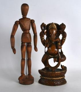 AN INDIAN CARVED WOOD FIGURE OF GANESH together with an