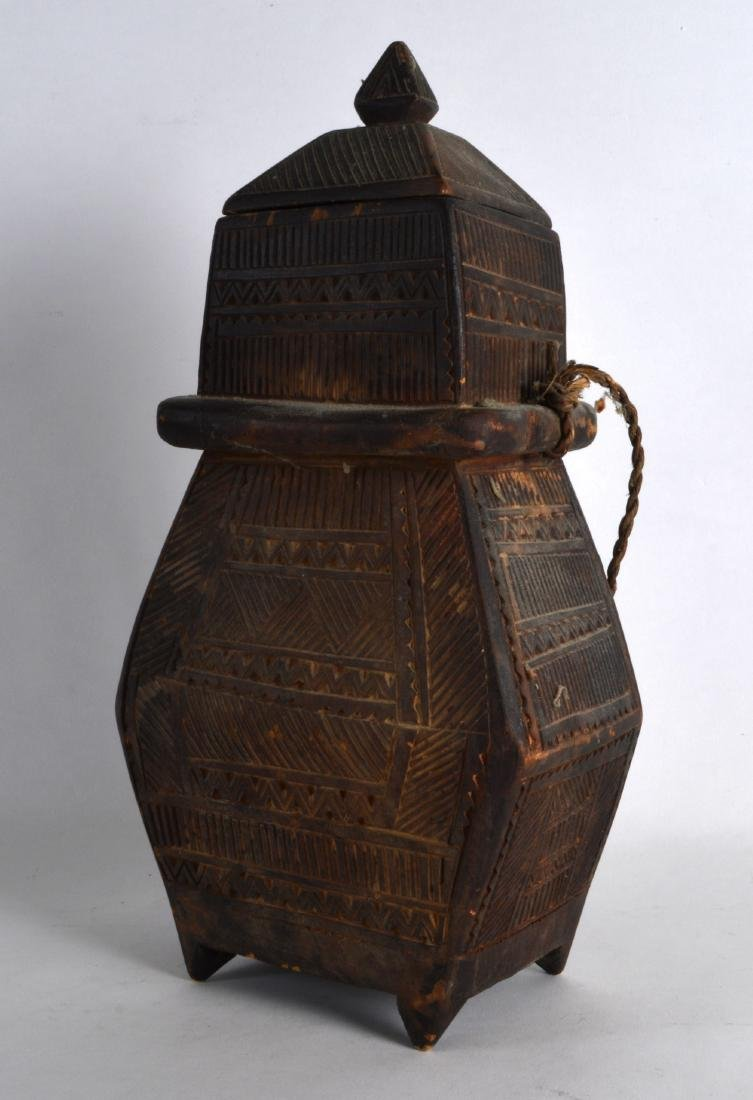 A SOUTHSEA ISLANDS CARVED WOOD STORAGE JAR AND COVER