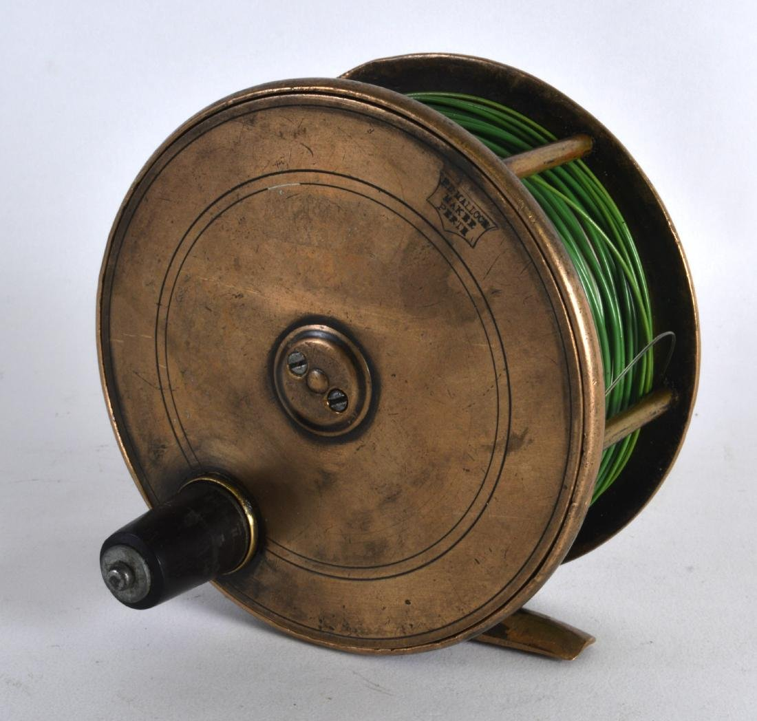 AN ANTIQUE SCOTTISH FISHING REEL stamped P D Malloch