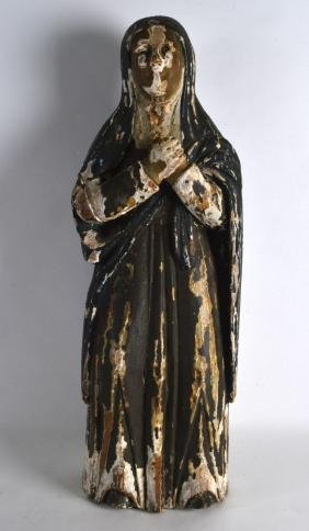 AN 18TH CENTURY SOUTH EUROPEAN POLYCHROMED WOOD FIGURE