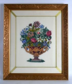 A FRAMED CANADIAN NEEDLEWORK STUDY AN URN OF FLOWERS.