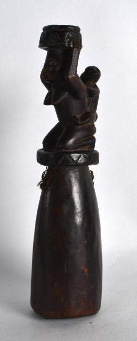 AN AFRICAN CARVE WOOD TRIBAL BELL modelled as a female