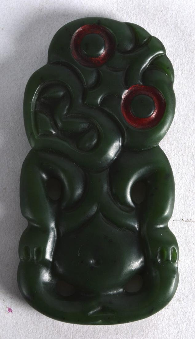 A GOOD LARGE MAORI CARVED JADE TIKI with red painted