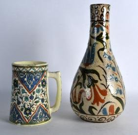 AN INDIAN ARTS AND CRAFTS STYLE POTTERY VASE together