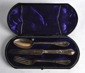 A CASED VICTORIAN KNIFE FORK AND SPOON SET.