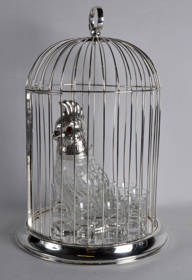 A NOVELTY SILVER PLATED PARROT DECANTER AND CAGE.