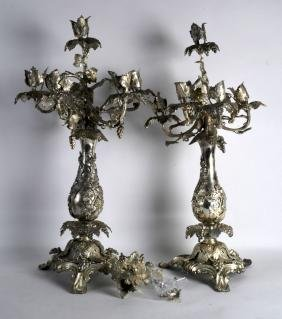 A VERY LARGE PAIR OF VICTORIAN SILVER PLATED CANDLEABRA