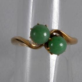 AN ANTIQUE 18CT YELLOW GOLD AND APPLE JADE CROSSOVER