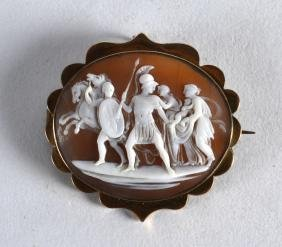AN ANTIQUE CAMEO BROOCH set with yellow metal. 1.75ins