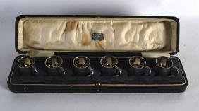 AN UNUSUAL SET OF CASED EDWARDIAN SILVER MINIATURE PINT