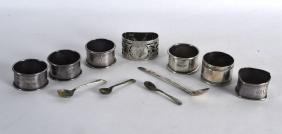 A COLLECTION OF SILVER NAPKIN RINGS together with