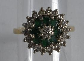 AN 18CT GOLD EMERALD AND DIAMOND FANCY RING.