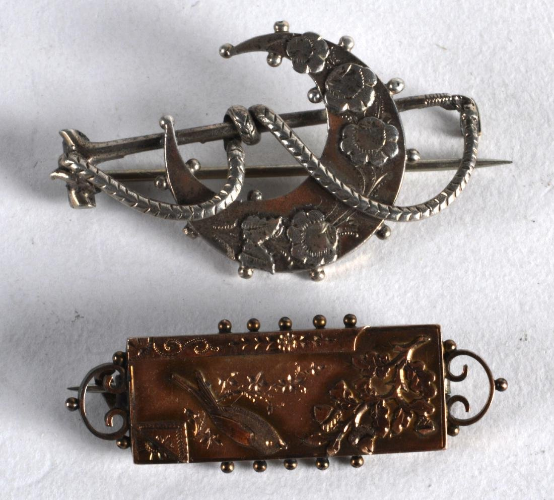 TWO ENGLISH AESTHETIC MOVEMENT SILVER BROOCHES in the