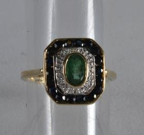 A 9CT EMERALD SAPPHIRE AND DIAMOND RING.