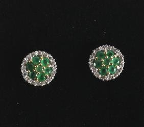 A PAIR OF 9CT GOLD EMERALD AND DIAMOND EARRINGS.