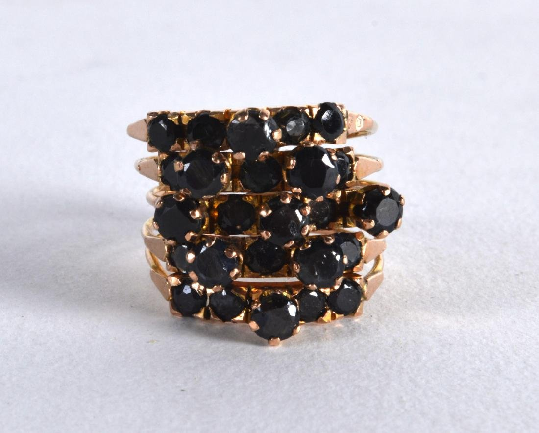 AN ANTIQUE GOLD AND FIVE BAND SAPPHIRE RING.