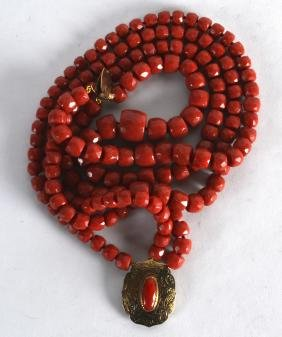 AN 18CT YELLOW GOLD AND CARVED RED CORAL NECKLACE. 233