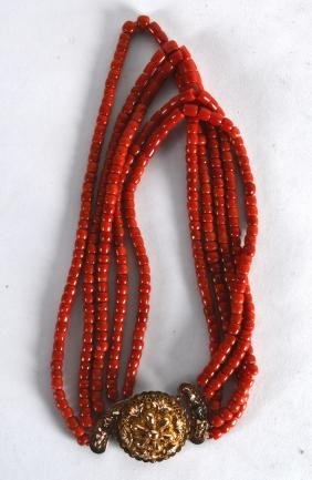 AN 18CT YELLOW GOLD AND CARVED RED CORAL NECKLACE. 183
