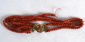 A YELLOW GOLD MOUNTED RED CORAL NECKLACE. 70 grams. 1Ft