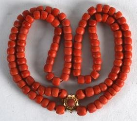 A YELLOW GOLD MOUNTED RED CORAL NECKLACE. 80 grams.