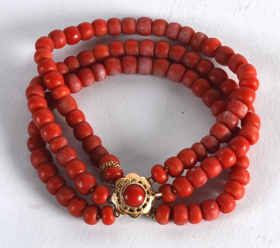 A YELLOW GOLD MOUNTED RED CORAL BRACELET. 38 grams.