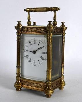 AN EARLY 20TH CENTURY FRENCH BRASS CARRIAGE CLOCK with