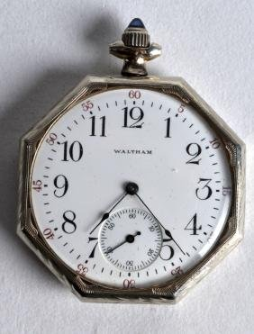 A 14CT WHITE GOLD WALTHAM POCKET WATCH. 2.25ins wide.