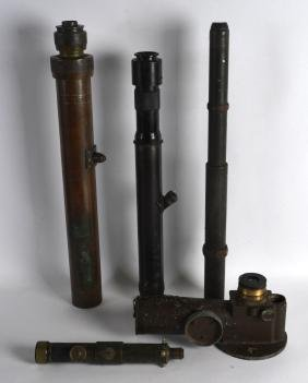 A GROUP OF FOUR MILITARY GUN SIGHTS and another,