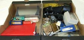 TWO BOXES CONTAINING CAMERA EQUIPMENT, including a