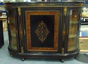 A VICTORIAN EBONISED CREDENZA. 3Ft 5ins wide.