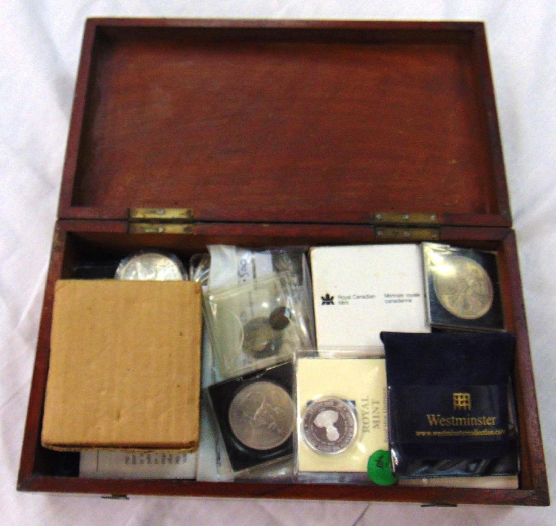 A BOXED WUANTITY OF MIXED COINS. (QTY)