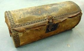 A HIDE CASKET DOME TOP TRUNK, with brass stud work.