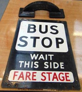A CAST IRON BUS STOP SIGN, together with a stick